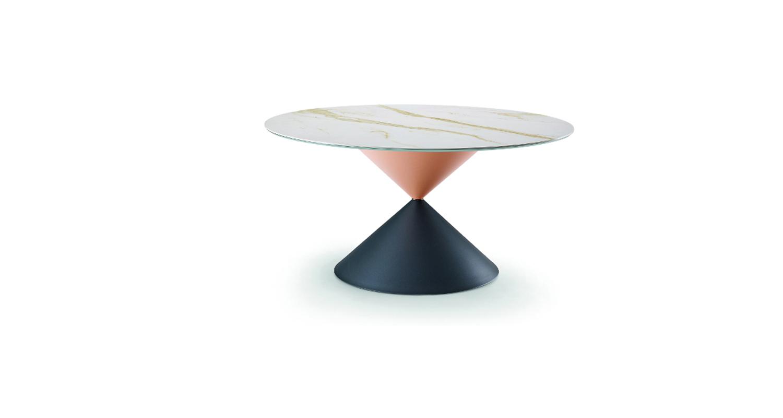 Mesa fija con base de acero macizo y cubierta de madera enchapada lacada o cristal-cerámico.