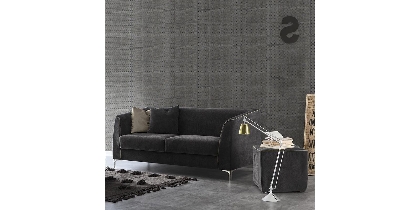 Sofá italiano esquina Spagnol Group en una sala de estar.
